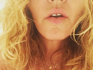 Madonna Wears a Grill and Nothing Else to Support Hillary Clinton