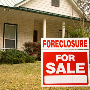 foreclosure for sale sign outside a house
