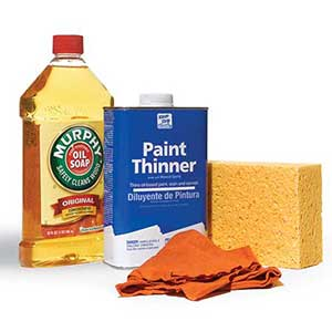 woodwork cleaners: Murphy Oil Soap, paint thinner, rag, sponge