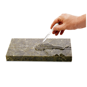 man holding a dropper with sealant in it above a stone slab
