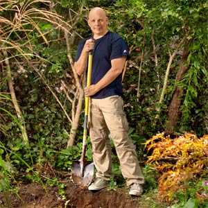 Scott Omelianuk digging in his backyard