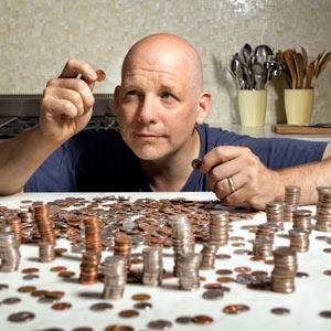 TOH Editor Scott Omelianuk counting coins