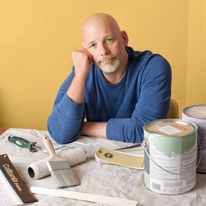 toh editor Scott Omelianuk standing near paint swatches and paint cans for his editorial letter On Home Remodels: This Time it's Personal