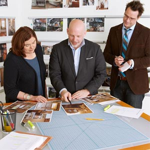 TOH editor Scott Omelianuk, center, reviews Reader Remodel Contest entries with deputy editor Kathryn Keller and special projects editor Eric Hagerman.