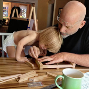 toh editor Scott Omelianuk and his son, Luca, working together to assemble a toy catapult.