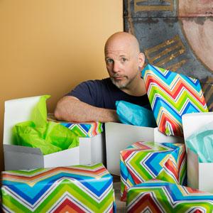 Scott Omelianuk amid gift-wrapped boxes