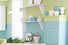 kitchen wall with colorblock paint job with teal on bottom and light green on top