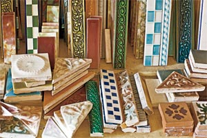 colorful collection of salvaged Victorian tile in many shapes, colors and patterns