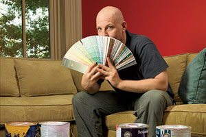 Scott Omelianuk with color swatches fanned in front of his face