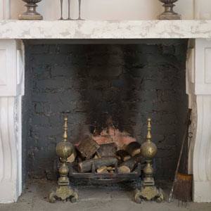 fireplace with black soot-stained brick box
