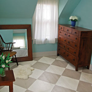 wood floors painted in checkered pattern