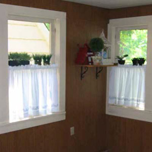 sun room with old dark wood paneling on walls