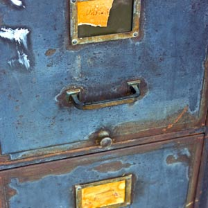 rusty old steel filing cabinet with peeling paint
