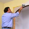 Conceal the new drywall patches with drywall tape and joint compound