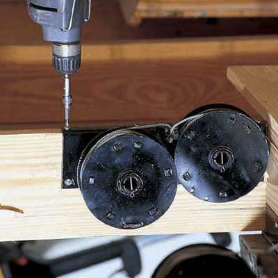 Install the spring drums for the pulley system that will allow staircase to slide down when attic door opens