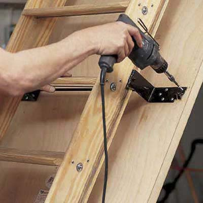 Attach stairs to door panel before enabling pulley system on attic stairs