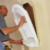 placing the niche into the wall for temporary install with adhesive to hold in place while nailing in