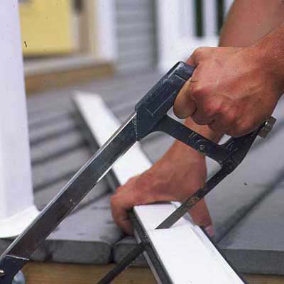 1. Cut the rolled-up screen and aluminum storage cassette down to size with a high-tension hacksaw.