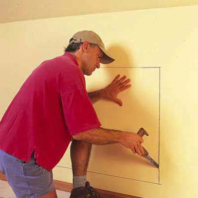 makring the outline of the dresser in the wall