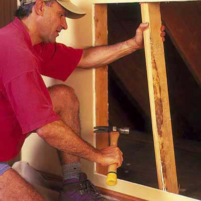 remove studs and insulation from inside the wall to make room for the dresser
