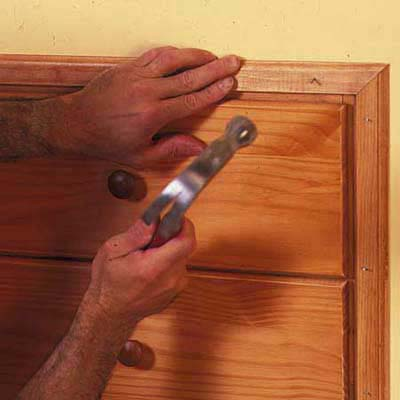 finish the knee-wall storage installation with attractive wood trim to  match dresser