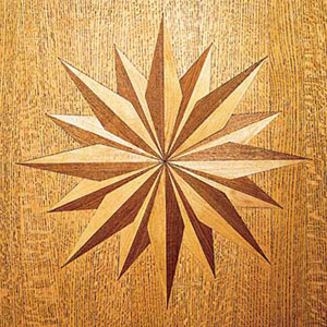 wood flooring with inlaid medallion