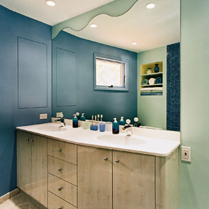 Watery hues for paint and tile and wavy mirror.
