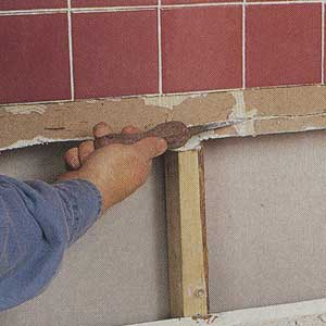 trimming the edge of the gypsum wallboard