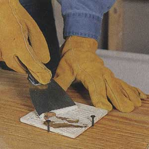 scraping ceramic tiles