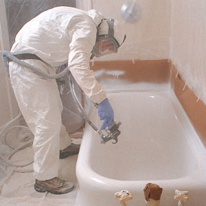 Spraying an acrylic urethane enamel over the bathtub's damaged porcelain.