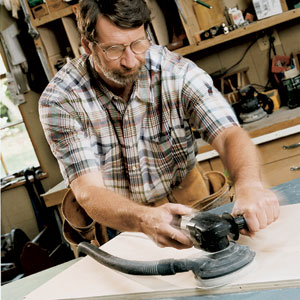 Norm Abram using a random-orbit sander