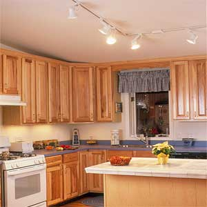 track lighting overhead and undercabinet lighting in kitchen