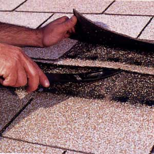 fixing roof shingles