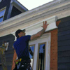Apply a bead of urethane adhesive to the back of the pediment, press it into position above the door