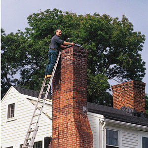 man climbing on the chimney 
