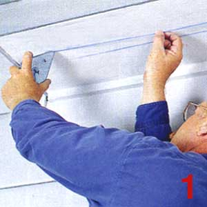 SNAP TWO parallel chalk lines 2 in. apart along the soffit to represent the cutout for the new strip vent.