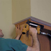 install finishing crown to top of cabinet unit