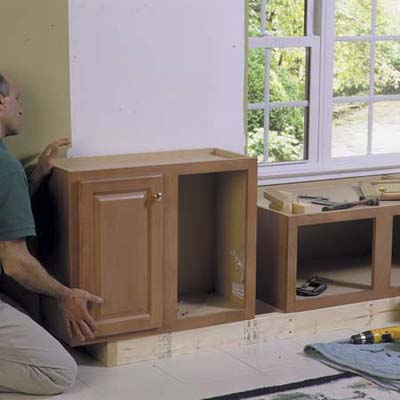 Install cabinets to toekick | How to Build a Window Seat