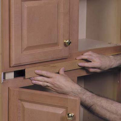 conceal the gaps between cabinets with molding