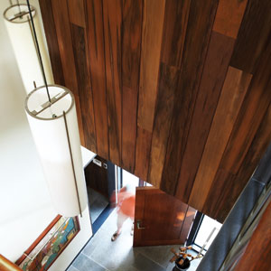 Olive-curing barrels repurposed as wood paneling