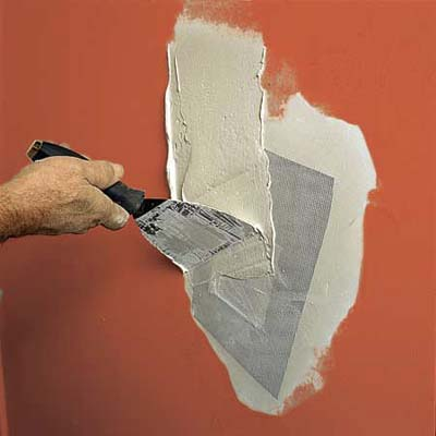 covering drywall patch seams with joint compound