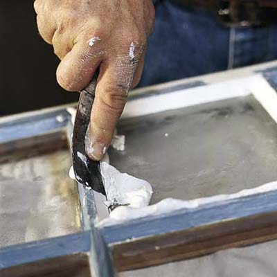 smoothing the putty witha  putty knife