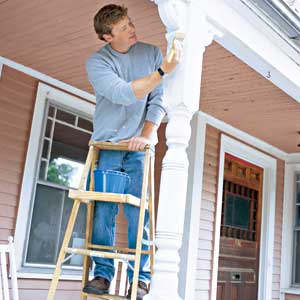 TOH host Kevin OConnor on a step ladder painting the porch 