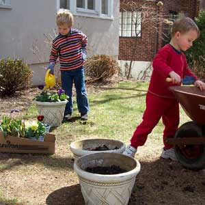 kids learning to work on the garden