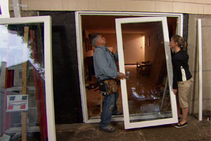 tom silva helping a homeowner install a sliding glass door