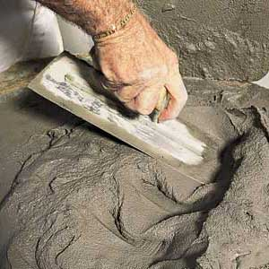 mixing cement stucco with a trowel