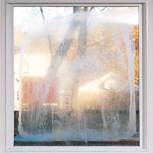 a fogged-up double-hung window
