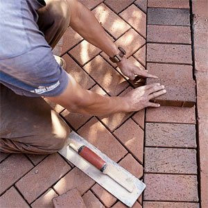setting brick into a brick patio