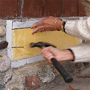 sealing up a crawl-space vent with rigid foam block