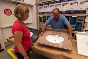 people picking out a sink in a home store